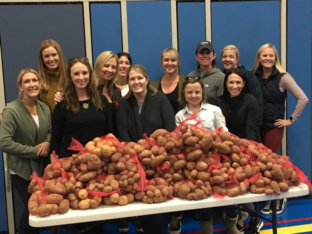 group of women in behind potatoes