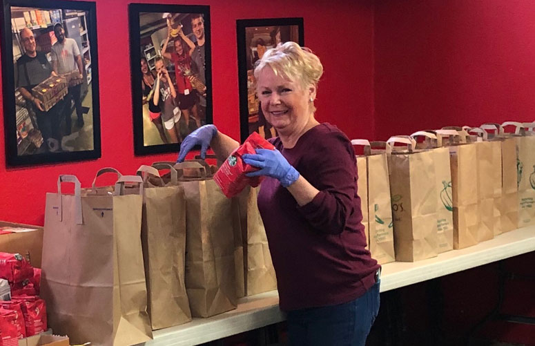 HCS Family Services stuffing bags to assist families in need.
