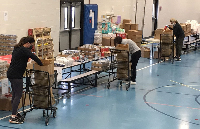 HCS Family Services volunteers pack food at Ann M Jeans Elementary School